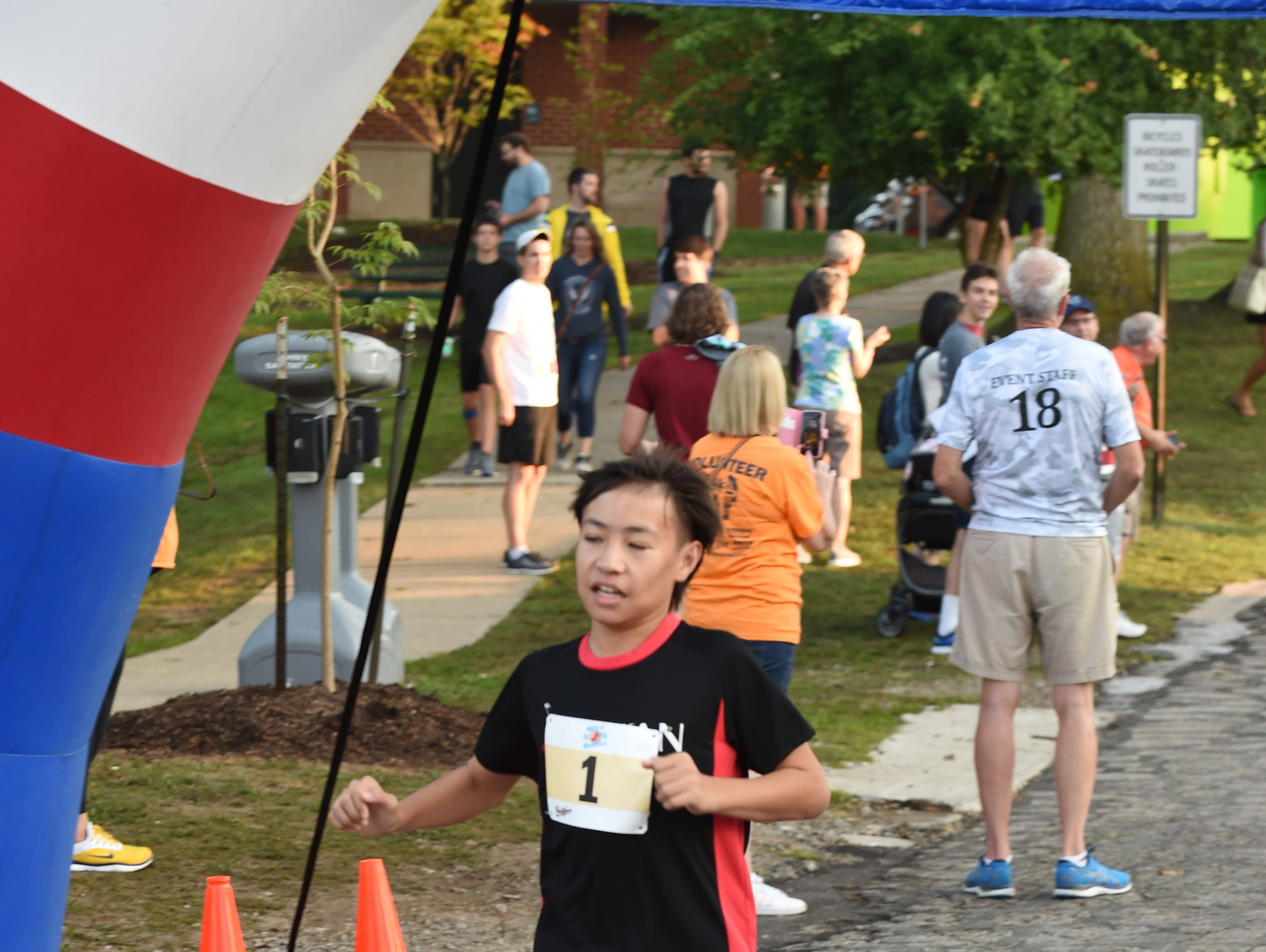 Kazuki Teuber from Kyoto, Japan, comes in first in the 1K run during Milford Memories.