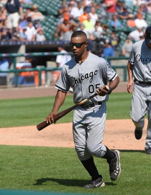 Lusire Boyd Jr. serves as the visiting bat boy and clubhouse attendant for the visiting teams at Comerica Park. On this day he's wearing the colors of the Chicago White Sox.