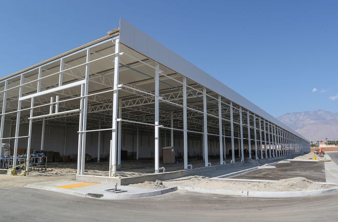 A massive warehouse is being constructed at 69375 Ramon Rd. in Cathedral City. The project sign describes the property as Ramon 19 cultivation, August 13, 2018.