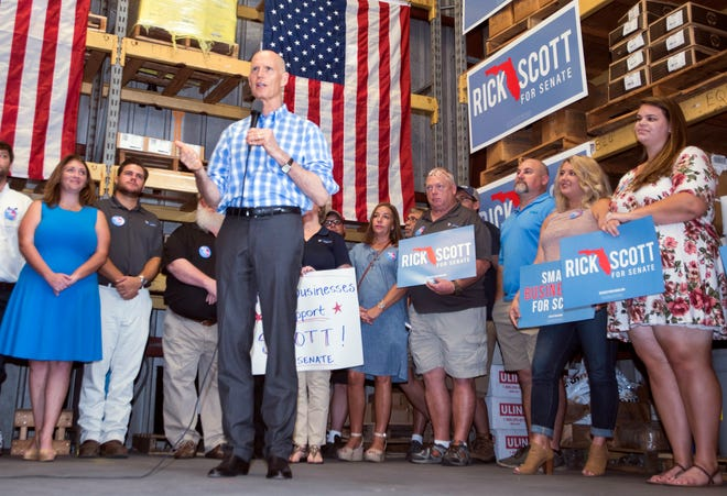 Gov. Rick Scott speaks to a group of supporters and employees Monday during a campaign stop at Threaded Fasteners Inc. in Pensacola.