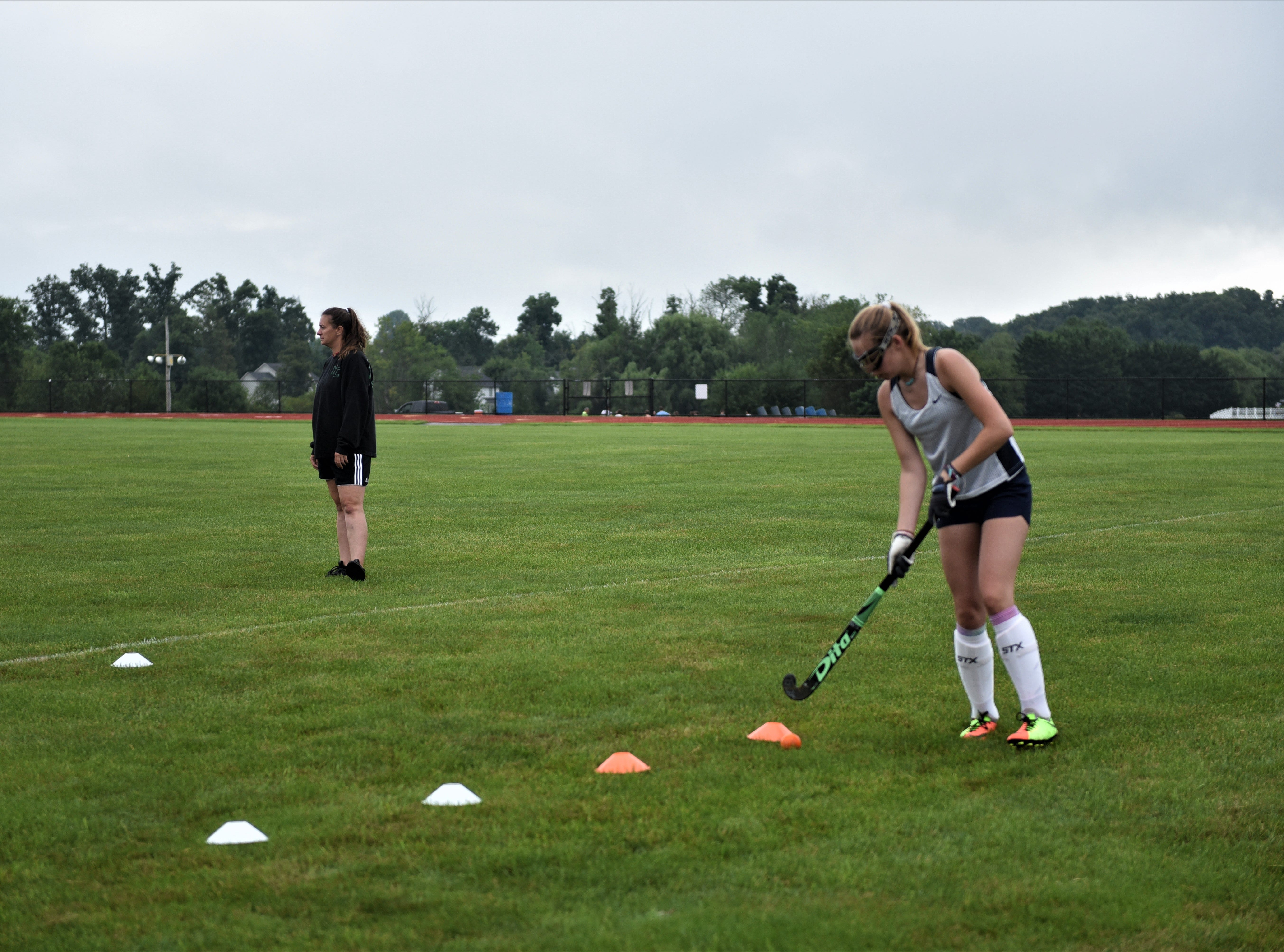 Caitlin Eader, Littlestown junior, gets ready for the field hockey season on the first day of fall sports on Monday, Aug. 13, 2018.