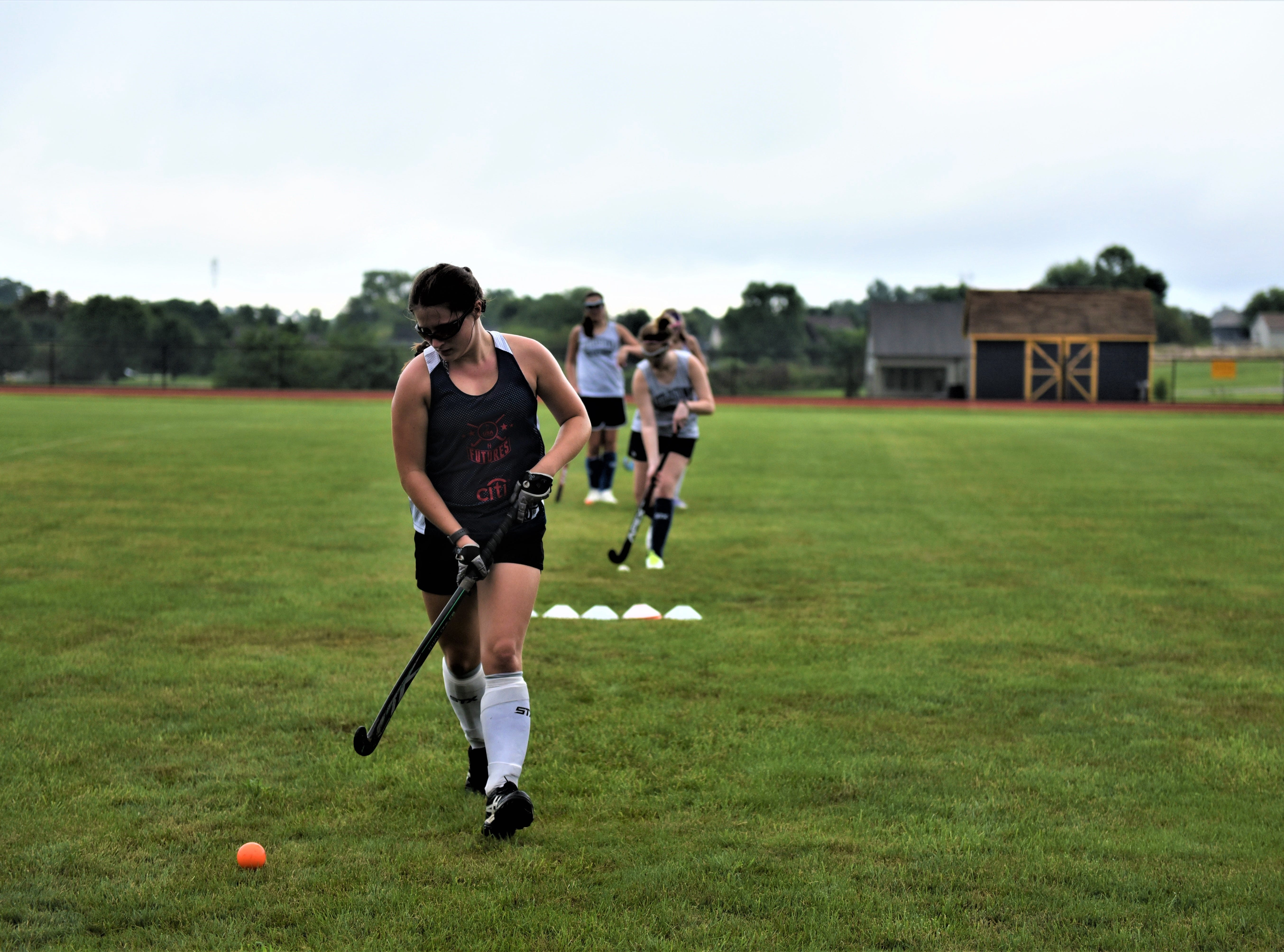 Regan Schroeder, a senior forward for Littlestown field hockey, practices on the first day of fall sports on Monday, Aug. 13, 2018.