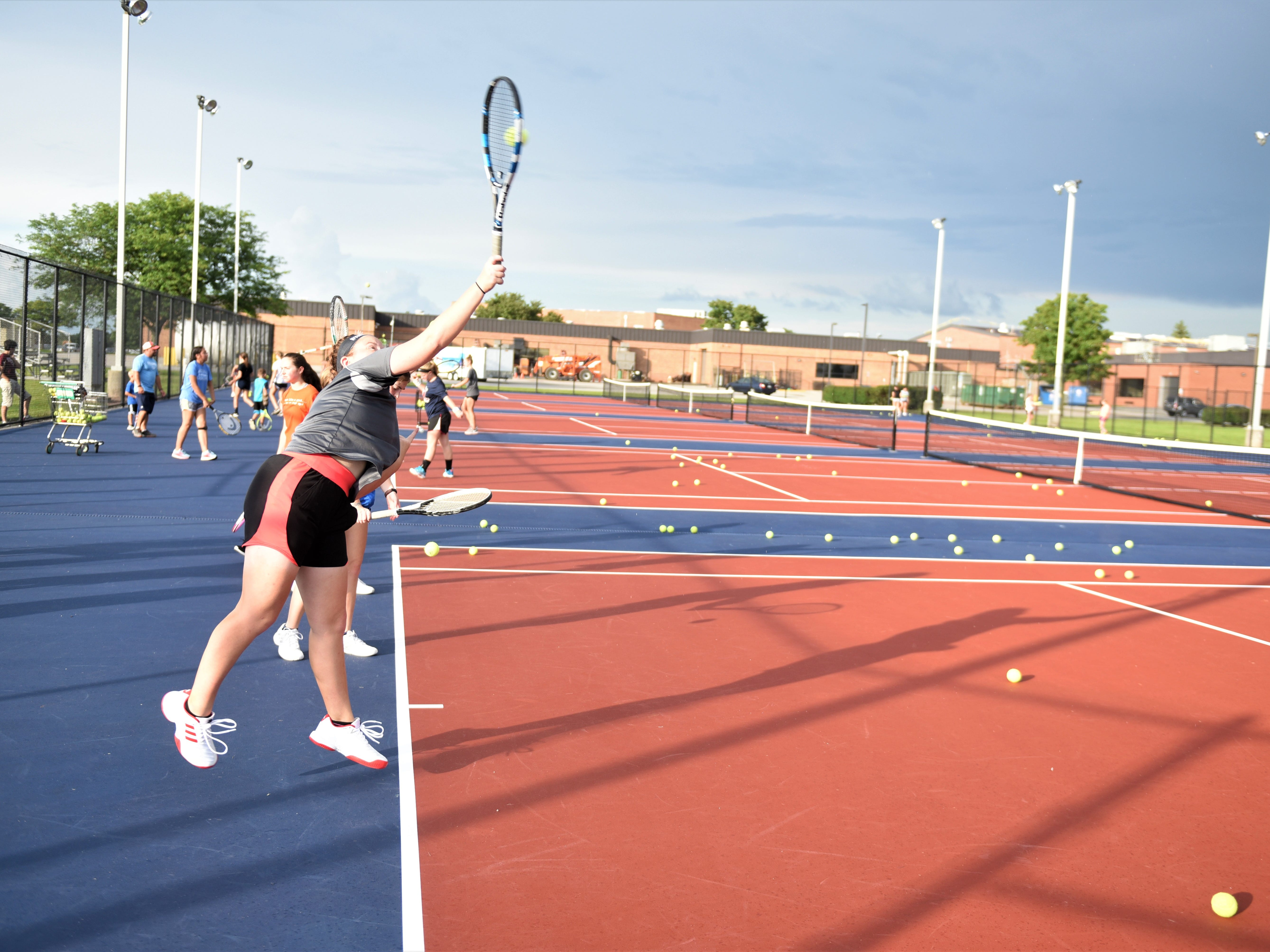 New Oxford junior, Molly Socks, is practicing her serve on the first day of fall sports on Aug. 13.