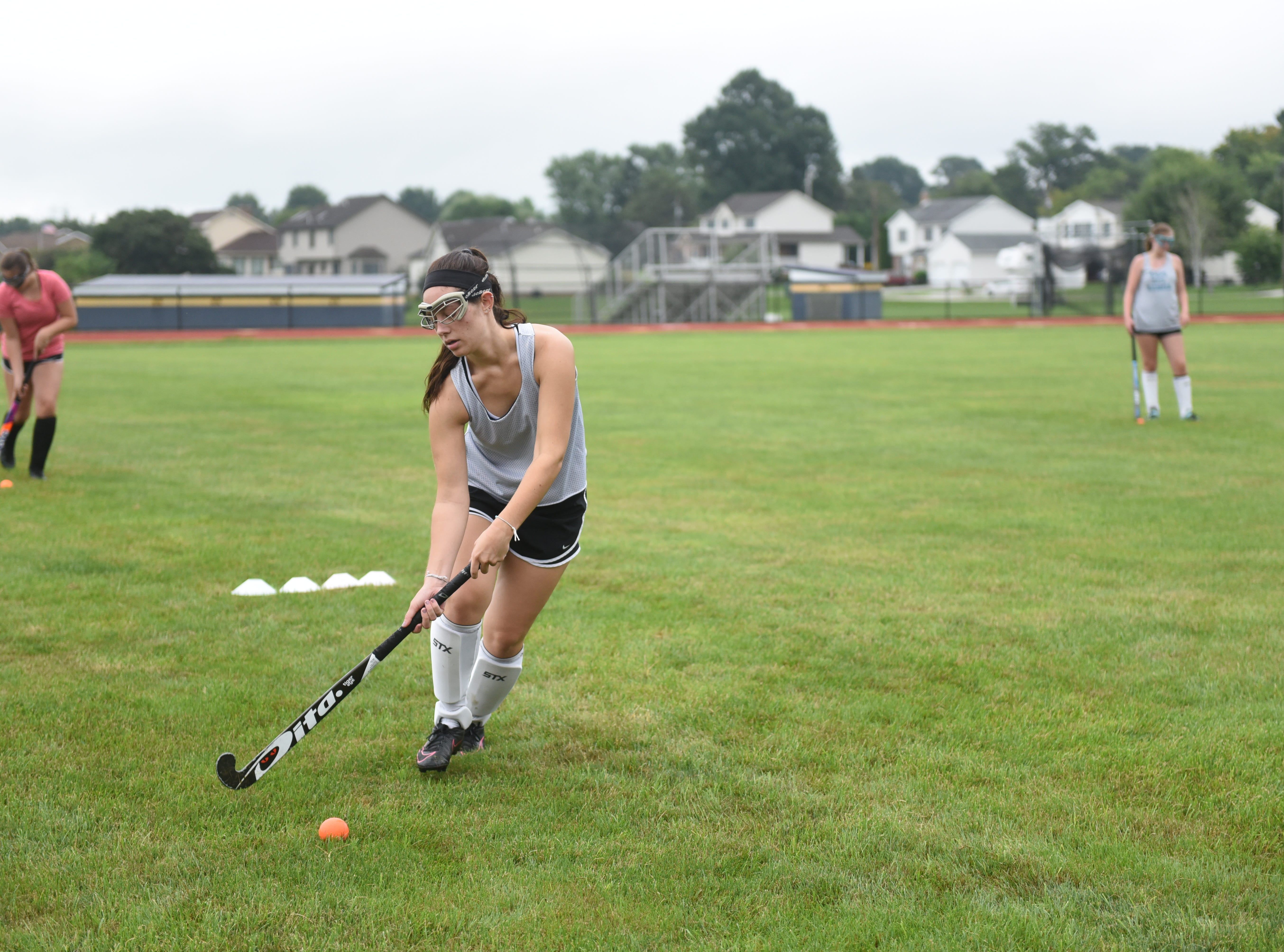 Kelsey Abrams, a senior defense player for Littlestown field hockey, runs through a drill on the first day of fall sports on Monday, Aug. 13, 2018.