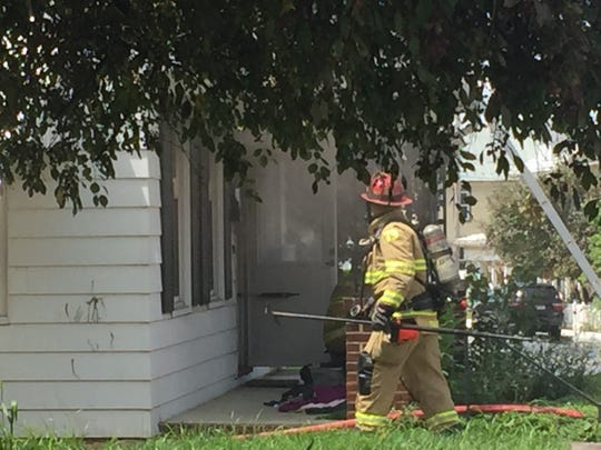 Hanover Area Fire and Rescue work on a residential structure fire in the 200 block of 3rd Street in Hanover Borough on Aug. 13, 2018.