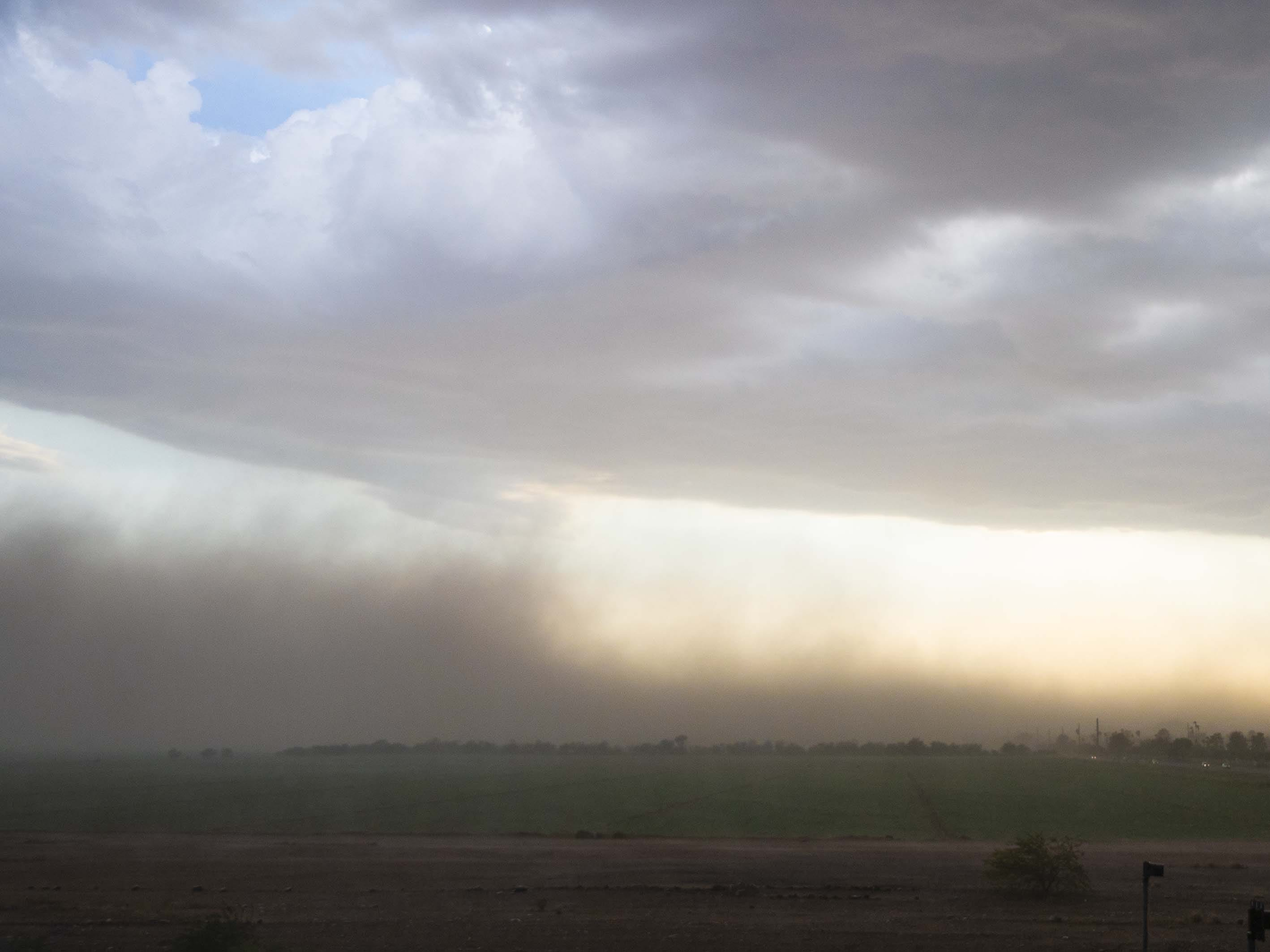 Blowing dust in a field near the Loop 101 and Loop 202, Ariz. during a monsoon storm August 12, 2018.