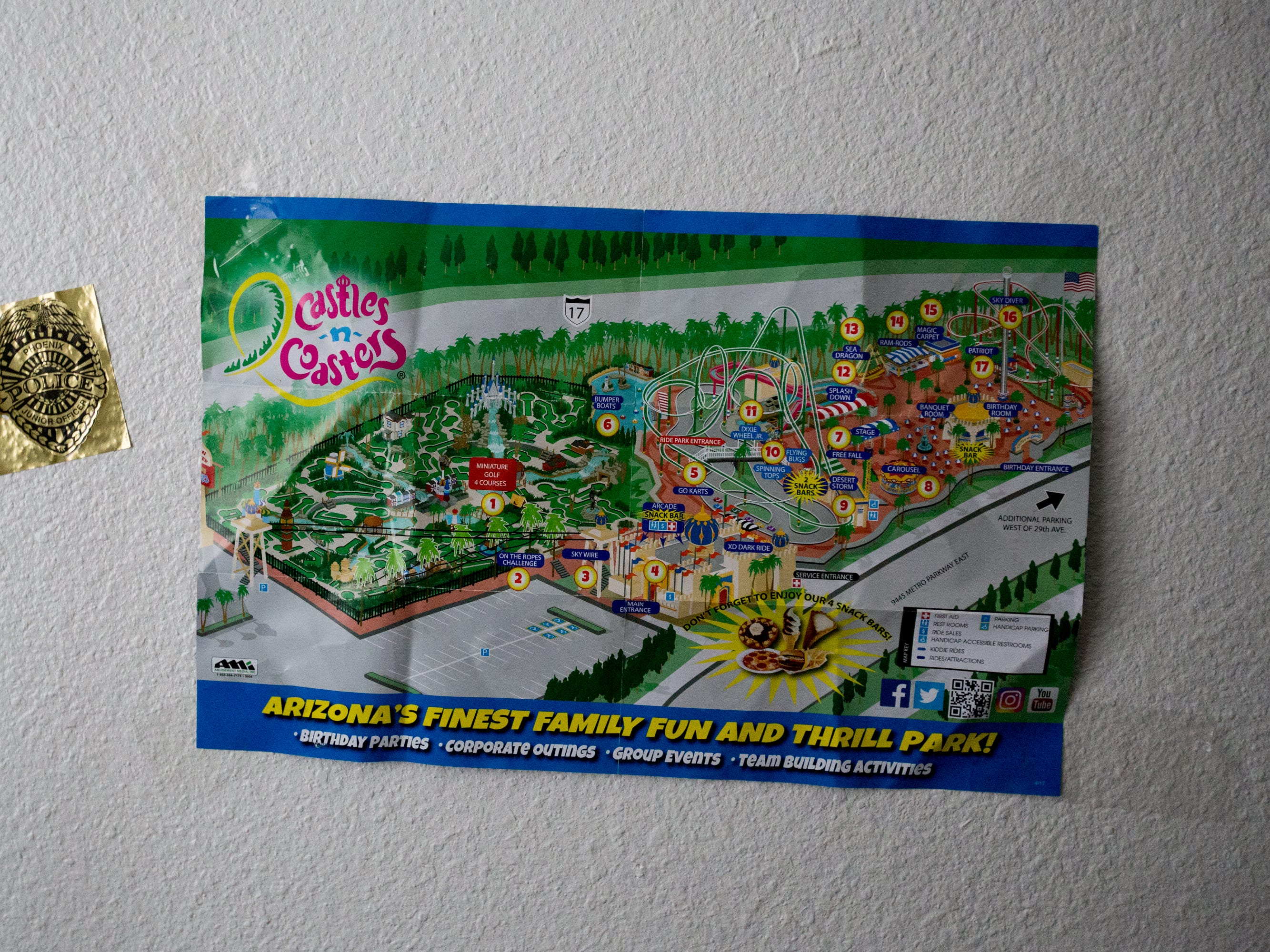 "A ""Castles and Coasters"" map hangs in Aida Waleska Marquez's apartment. Her son, Lionel, put up the sign after a family outing."