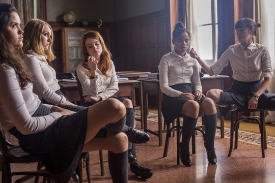 "Veronica (Victoria Moroles), Kit (AnnaSophia Robb), Sierra (Rosie Day), Ashley (Taylor Russell) and Izzy (Isabelle Fuhrman) are students at a strange boarding school in ""Down a Dark Hall."""