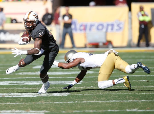 ASU receiver Jaelen Strong breaks a tackle by Notre Dame's Cole Luke during a 2014 game at Sun Devil Stadium in Tempe.