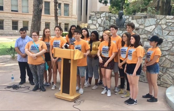 Jordan Harb, executive director of March for Our Lives Arizona, demands a response from Gov. Doug Ducey at a press conference in the Capitol rose garden  Aug. 13, 2018.