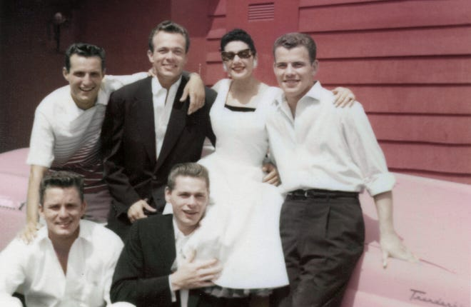 """A young Scotty Bowers take a photo with friends in """"Scotty and the Secret History of Hollywood."""""""