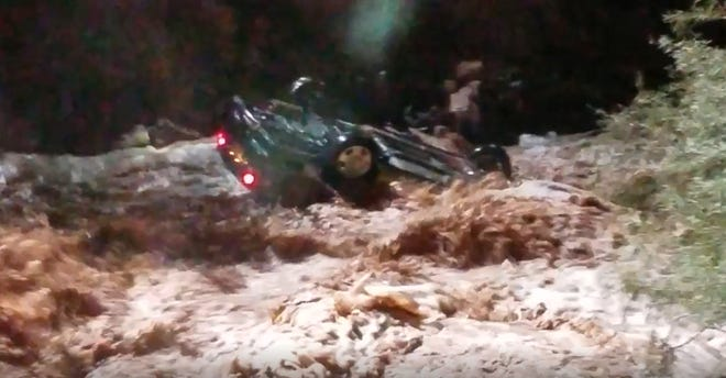 Pima County Rural Metro firefighters responded to a waterway south of Tucson on reports of an upside-down vehicle stuck in a steep wash.