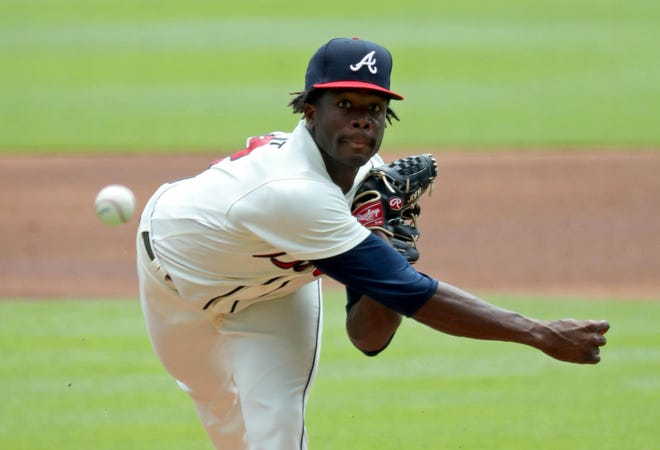 Atlanta Braves starting pitcher Touki Toussaint (62) delivers a pitch to an Miami Marlins batter in the first inning at SunTrust Park.