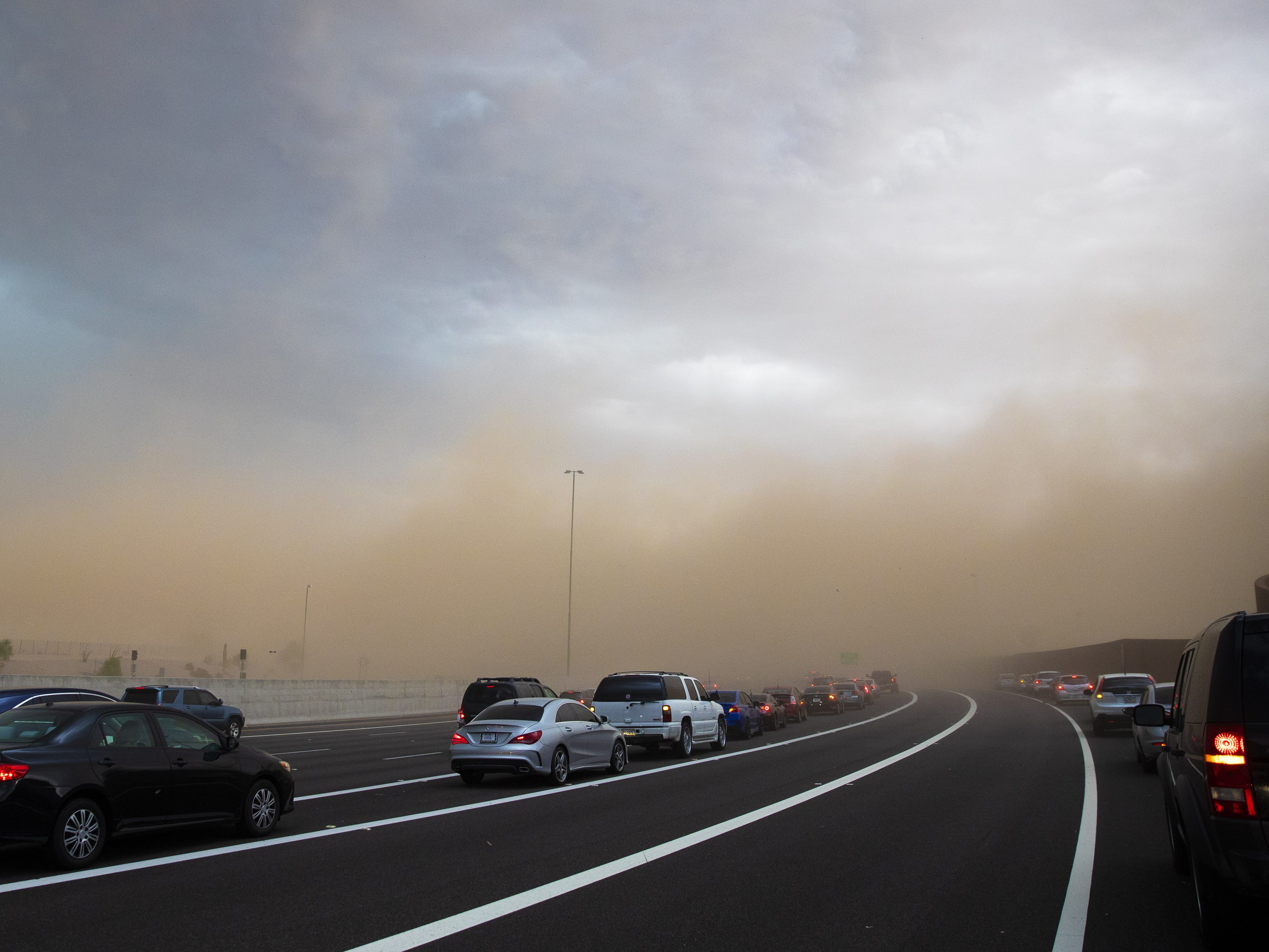 Blowing dust stops southbound traffic on the Loop 101 near E. Via Linda in Scottsdale, Ariz. during a monsoon storm August 12, 2018.