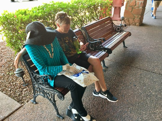 Cousin Theresa waits outside the store in Sedona with a newfound friend.