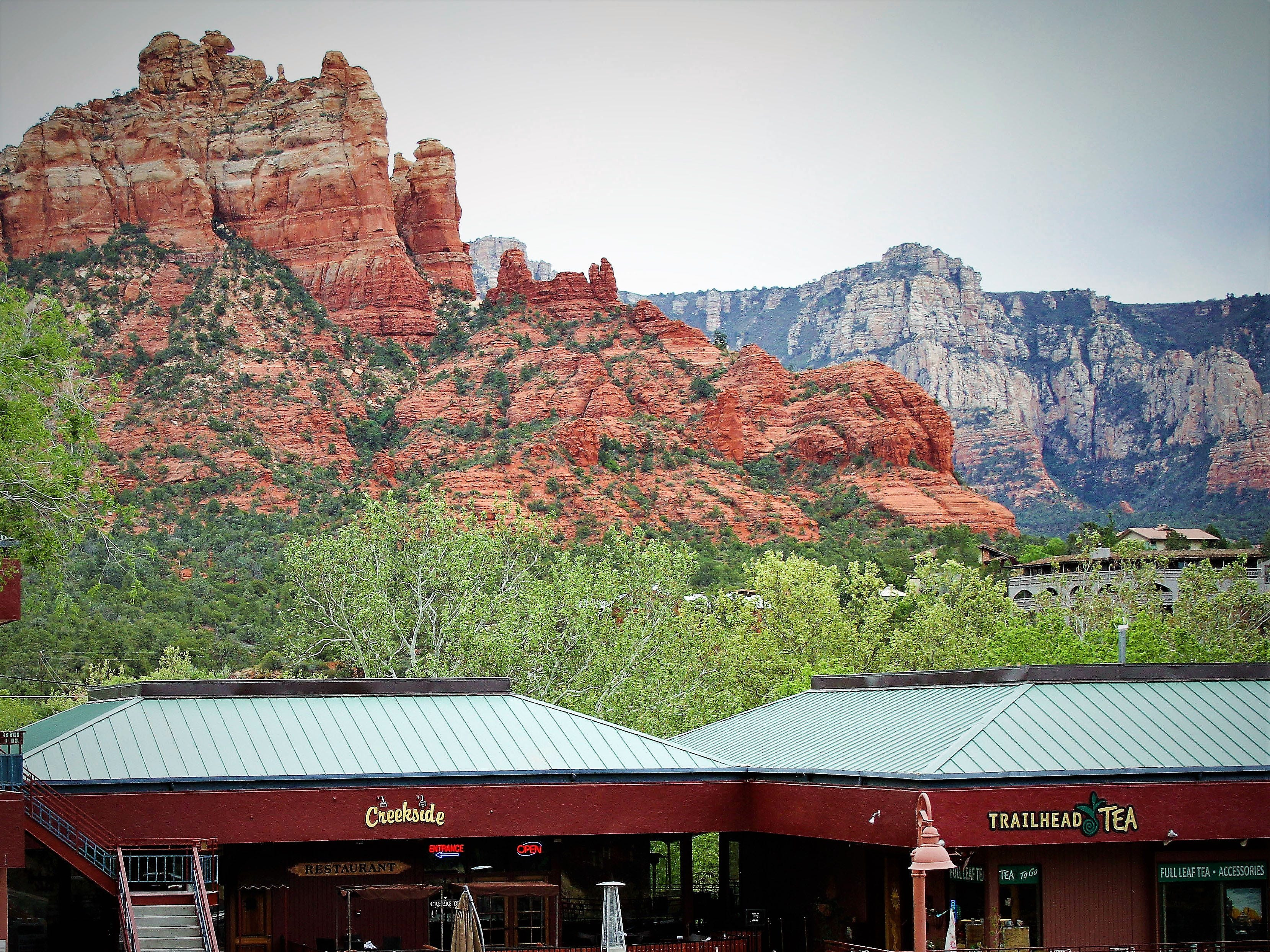 Creekside American Bistro perches on the edge of Oak Creek with views of Snoopy Rock and the surrounding cliffs.
