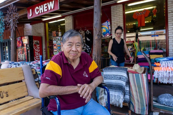 John Song, owner of J. Chew's Mexican Imports, sits outside the store in Scottsdale.