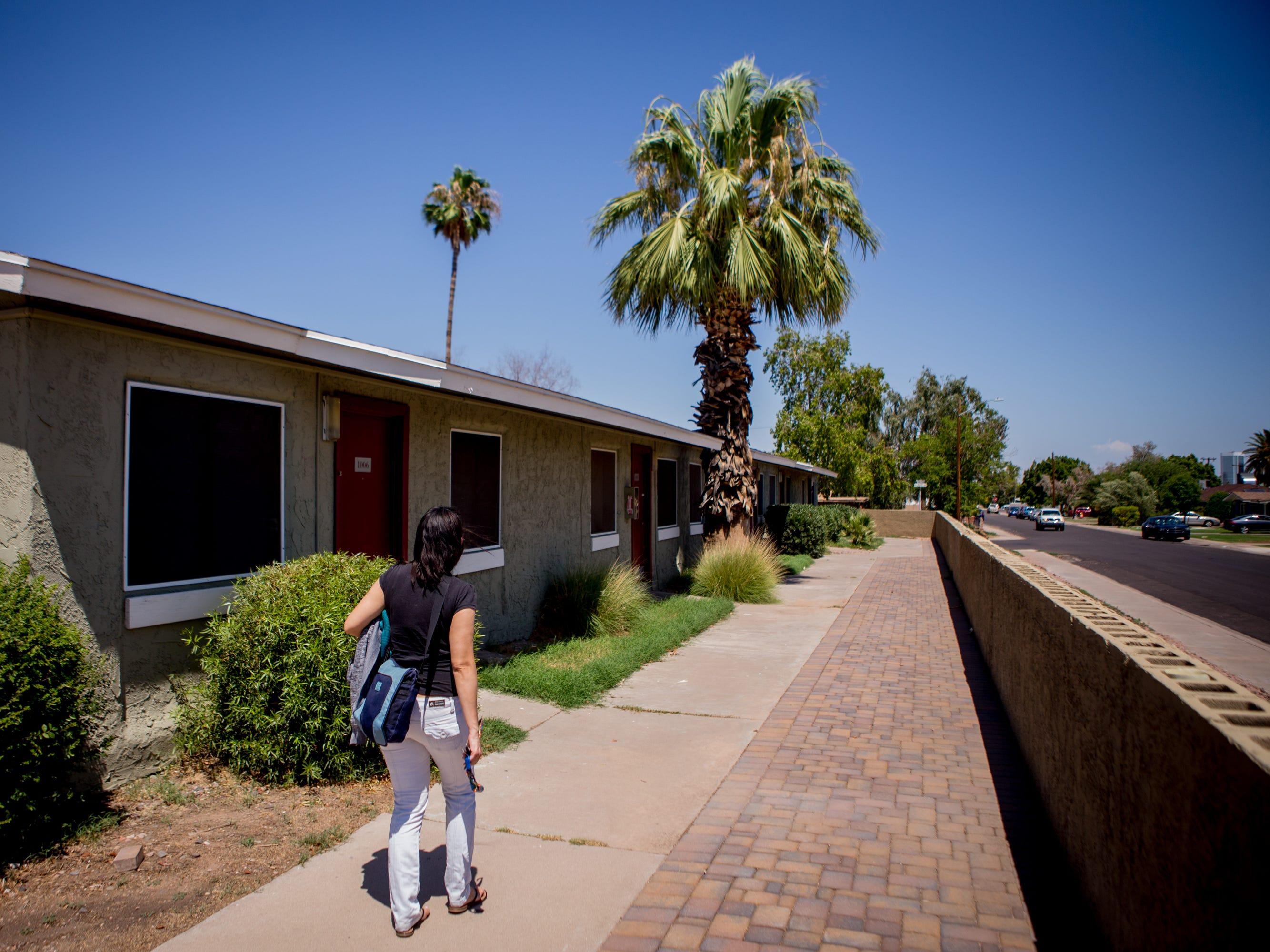 Aida Waleska Marquez walks to her apartment in Phoenix.
