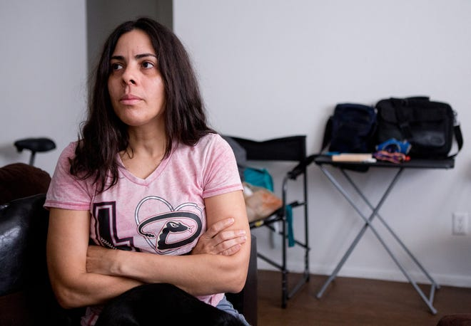 Aida Waleska Marquez pauses during an interview at her home in Phoenix. Marquez Ramos says that she wasn't able to look at imagery from Hurricane Maria until recently.