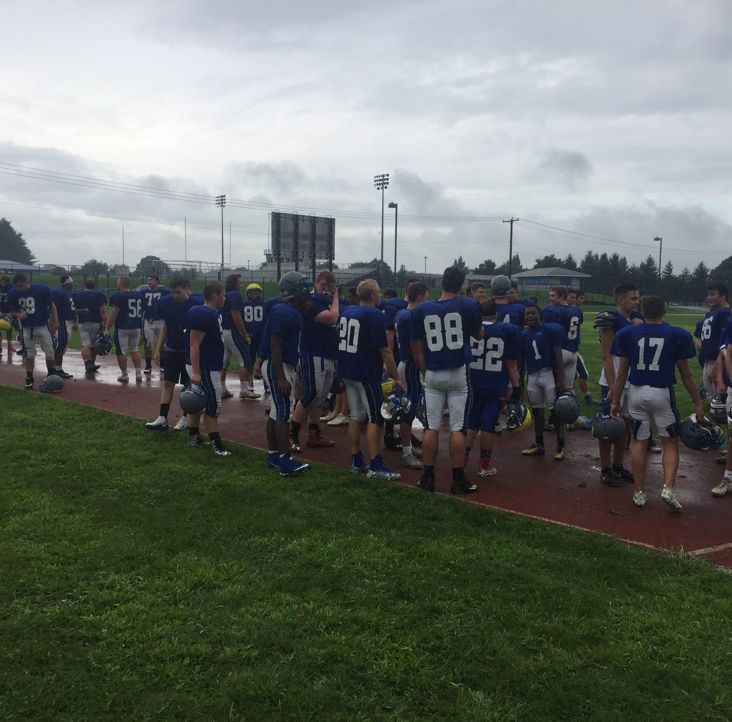 Rainy start fails to dampen spirits on first day of fall practice