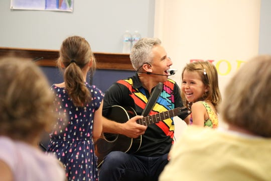 Children of all ages played, danced and sang along with Zak Morgan and Duke Otherwise at the Ida Rupp Public Library on Monday.