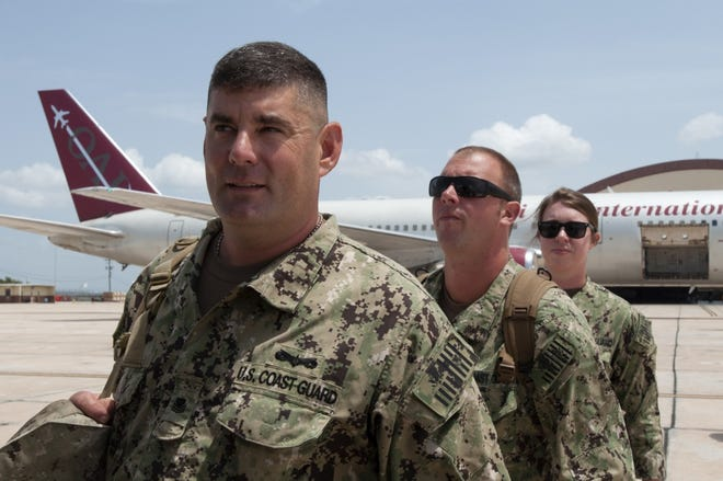 Members from Coast Guard Port Security Unit 309, home based out of Port Clinton, board a plane at Guantanamo Bay, Cuba airfield and return to Mansfield Lahn Air National Guard Base in Mansfield, on July 28 after a nine-month deployment.