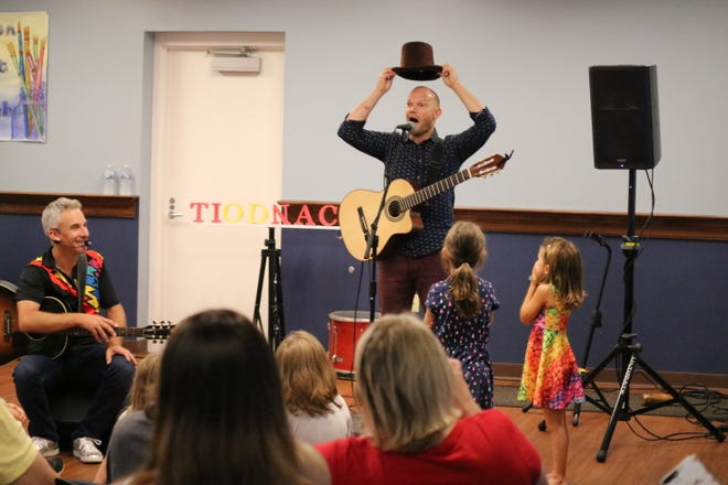Zak Morgan, left, and Duke Otherwise, right, performed together for the first at the Ida Rupp Public Library on Monday.