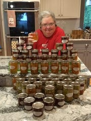 Terry Sennett is shown with an assortment of jams, jellies, pickles and salsa she recently canned,