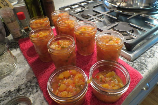 Terry Sennett's recipe for peach salsa is ready for the canning bath.