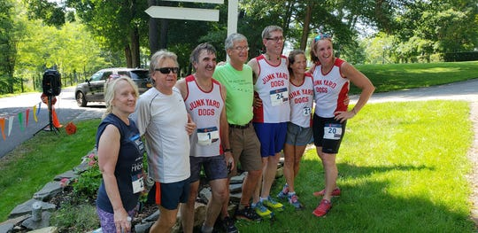 Members of the Junk Yard Dogs running club pose together at the Hilltopper Half Marathon in Millbrook.