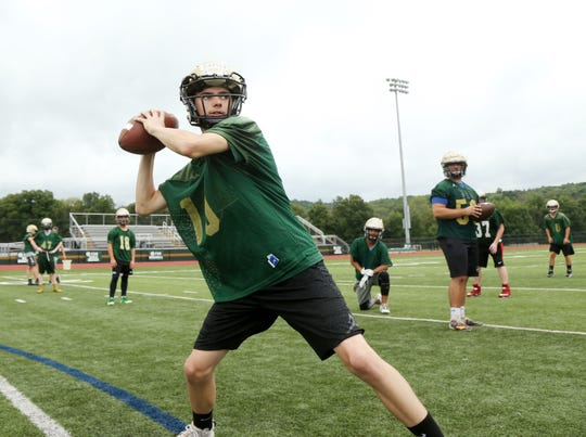 Franklin D. Roosevelt's Shane Baxter looks for his receiver during a preseason practice on August 13, 2018.