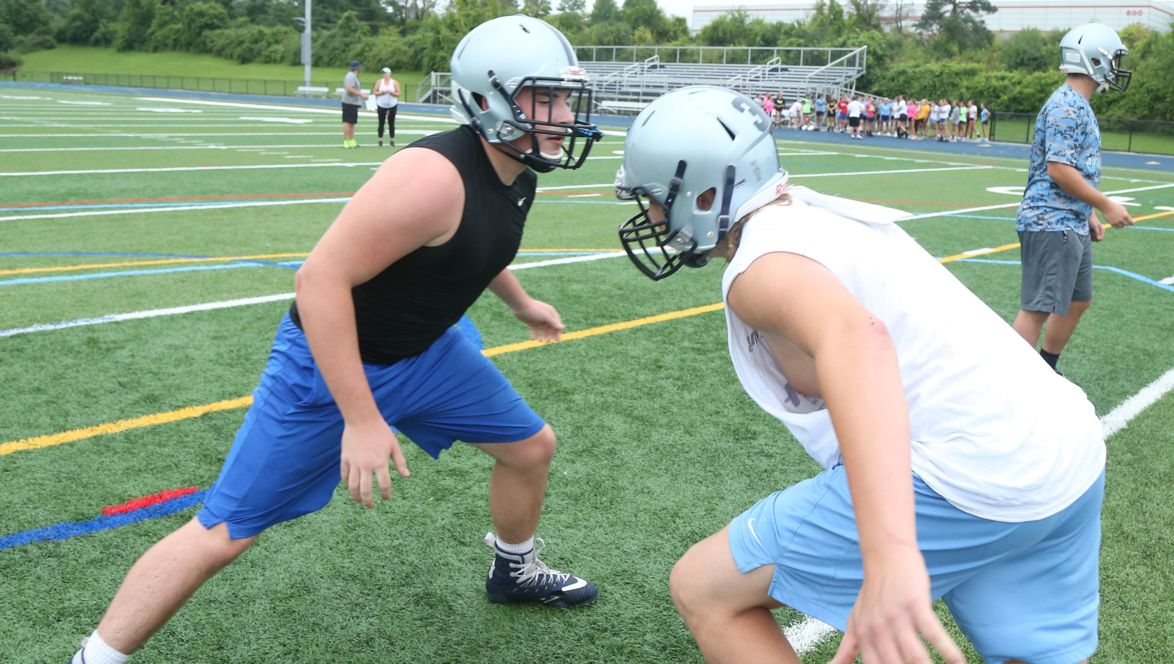 John Jay football linemen, from left, Patrick Whelan and Tommy Cavallo practice tackling during a preseason practice on August 13, 2018.