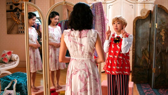 "Constance Wu, left, and Awkwafina in a scene from the film ""Crazy Rich Asians."" The movie opens Aug. 15 at Regal West Manchester Stadium 13."