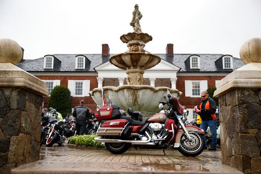 A Harley-Davidson motorcycle is parked with others in front of the clubhouse of Trump National Golf Club in Bedminster, N.J., Saturday, Aug. 11, 2018, before President Donald Trump meets with member of Bikers for Trump and supporters. (AP Photo/Carolyn Kaster)
