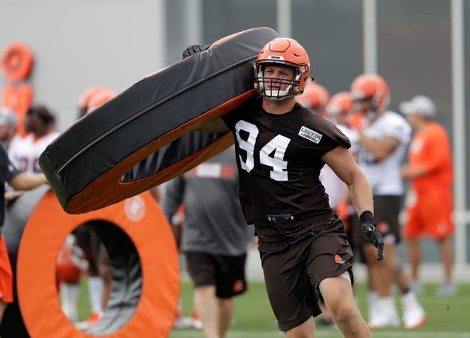FILE - In this Thursday, July 26, 2018, file photo, Cleveland Browns defensive end Carl Nassib runs a drill during NFL football training camp, in Berea, Ohio. Browns defensive end Nassib needs to work on more than his pass rushing skills in training camp. His grandma wants him to clean up his language. (AP Photo/Tony Dejak, File)