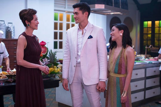 """From left, Michelle Yeoh, Henry Golding and Constance Wu in a scene from the film """"Crazy Rich Asians."""" The movie opens Aug. 15 at Regal West Manchester Stadium 13."""