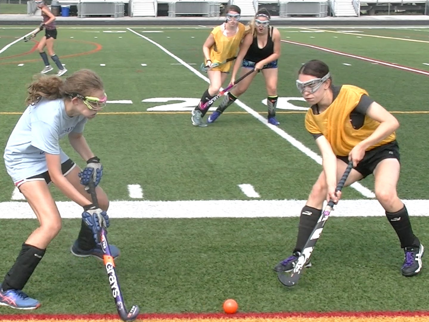 Members of Dallastown's field hockey team scrimmage on the first day of fall practice Monday, Aug. 13, 2018.