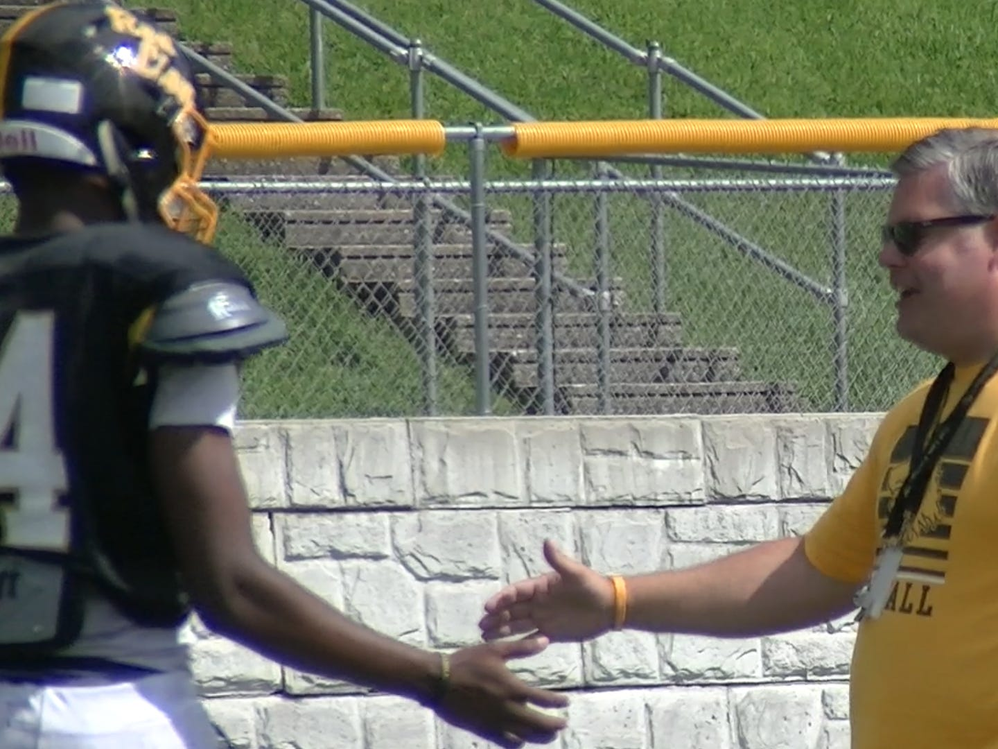 Red Lion defensive coordinator J.D. Granger congratulates Davante Dennis after he forced a fumble during the first day of practice Monday, Aug. 13, 2018.