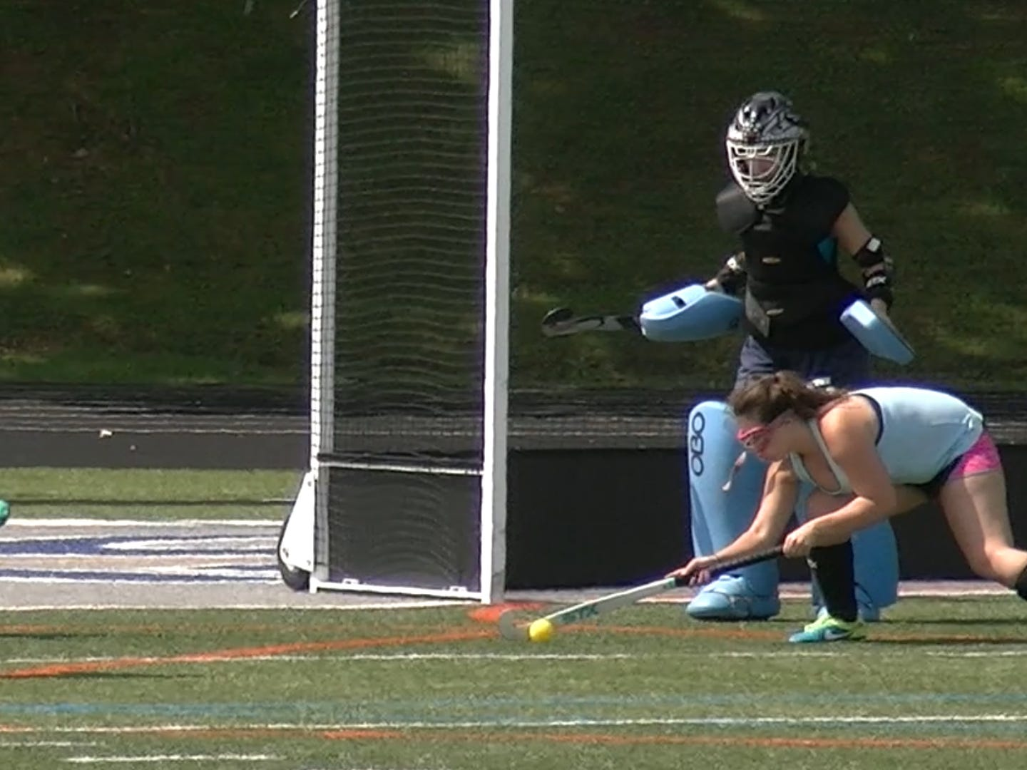 A Dallastown field hockey player reaches down to make a defensive stop in front of her goalie during the first day of fall sports practice Monday, Aug. 13, 2018.