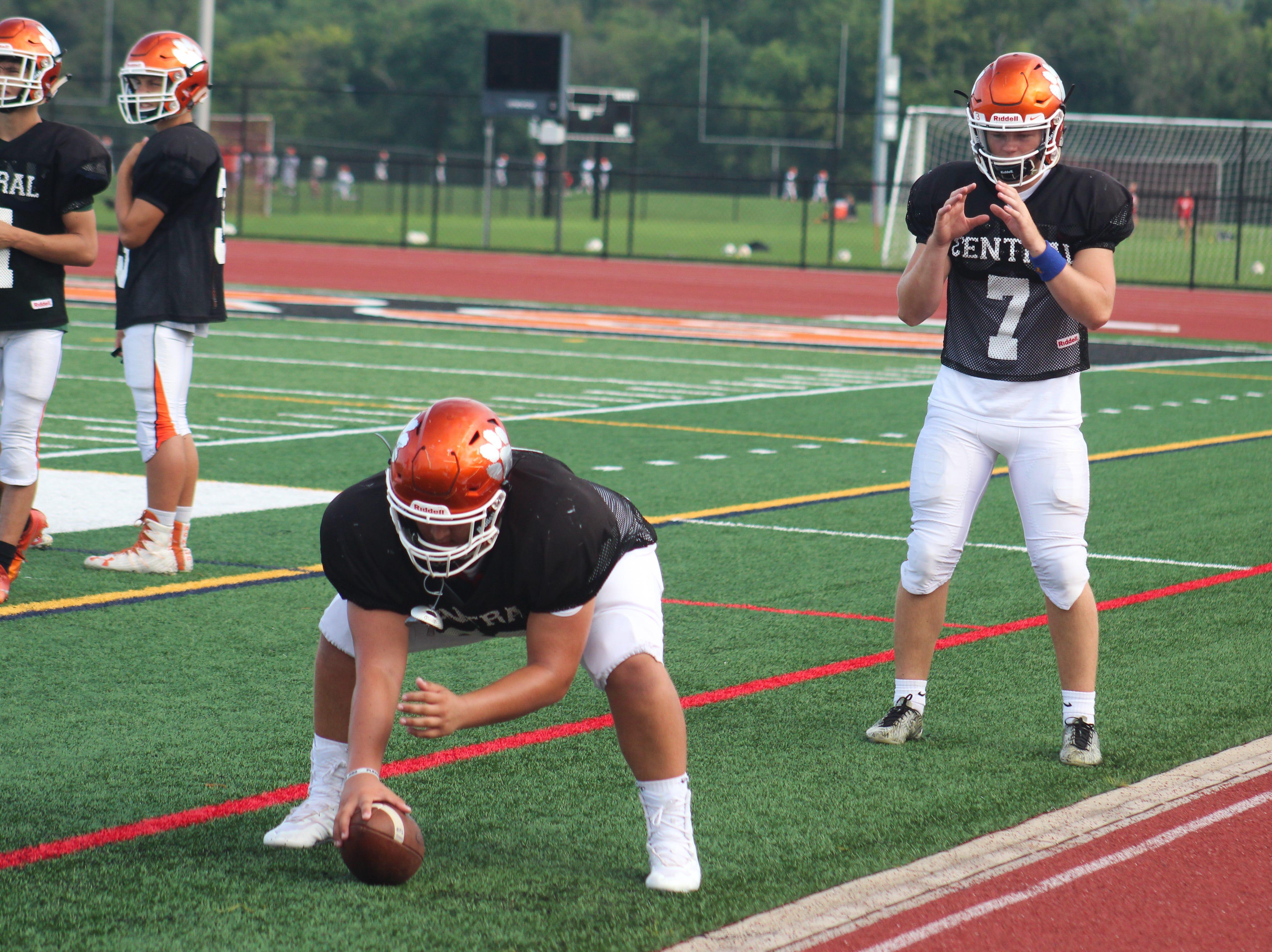 A quarterback and a center for Central York High School practice shotgun snaps.