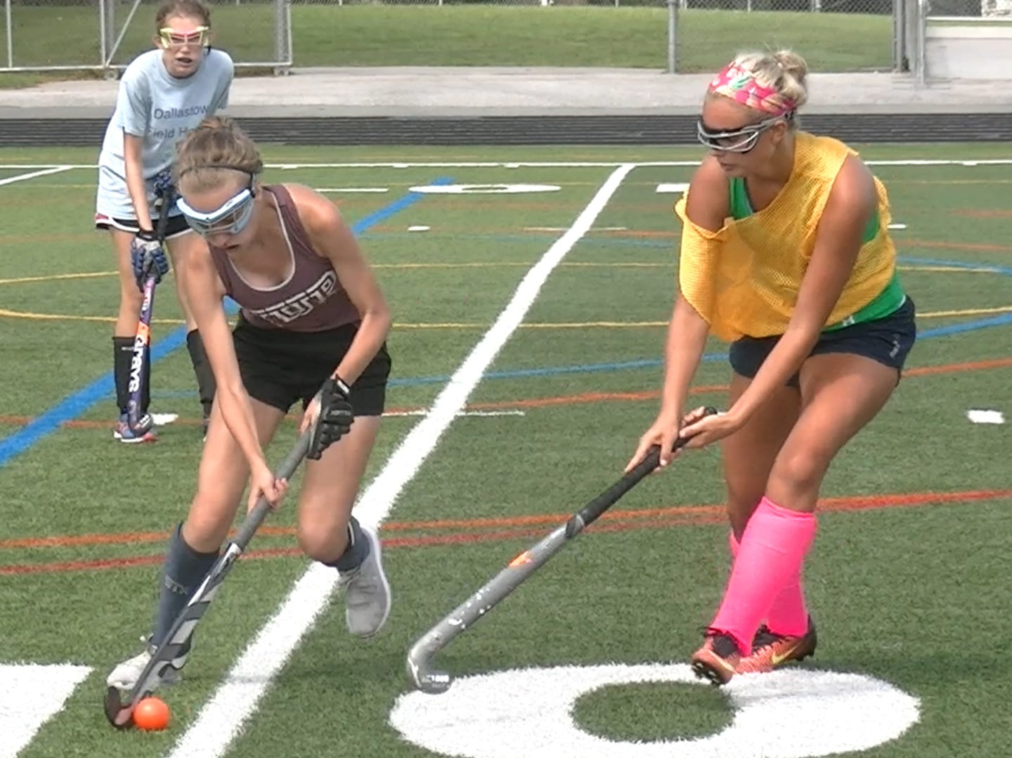 Members of Dallastown's field hockey team scrimmage during the first day of fall sports practice Monday, Aug. 13, 2018.
