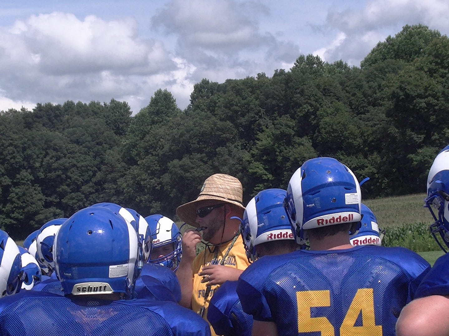 Kennard-Dale football coach Chris Grube addresses players at practice on Monday.