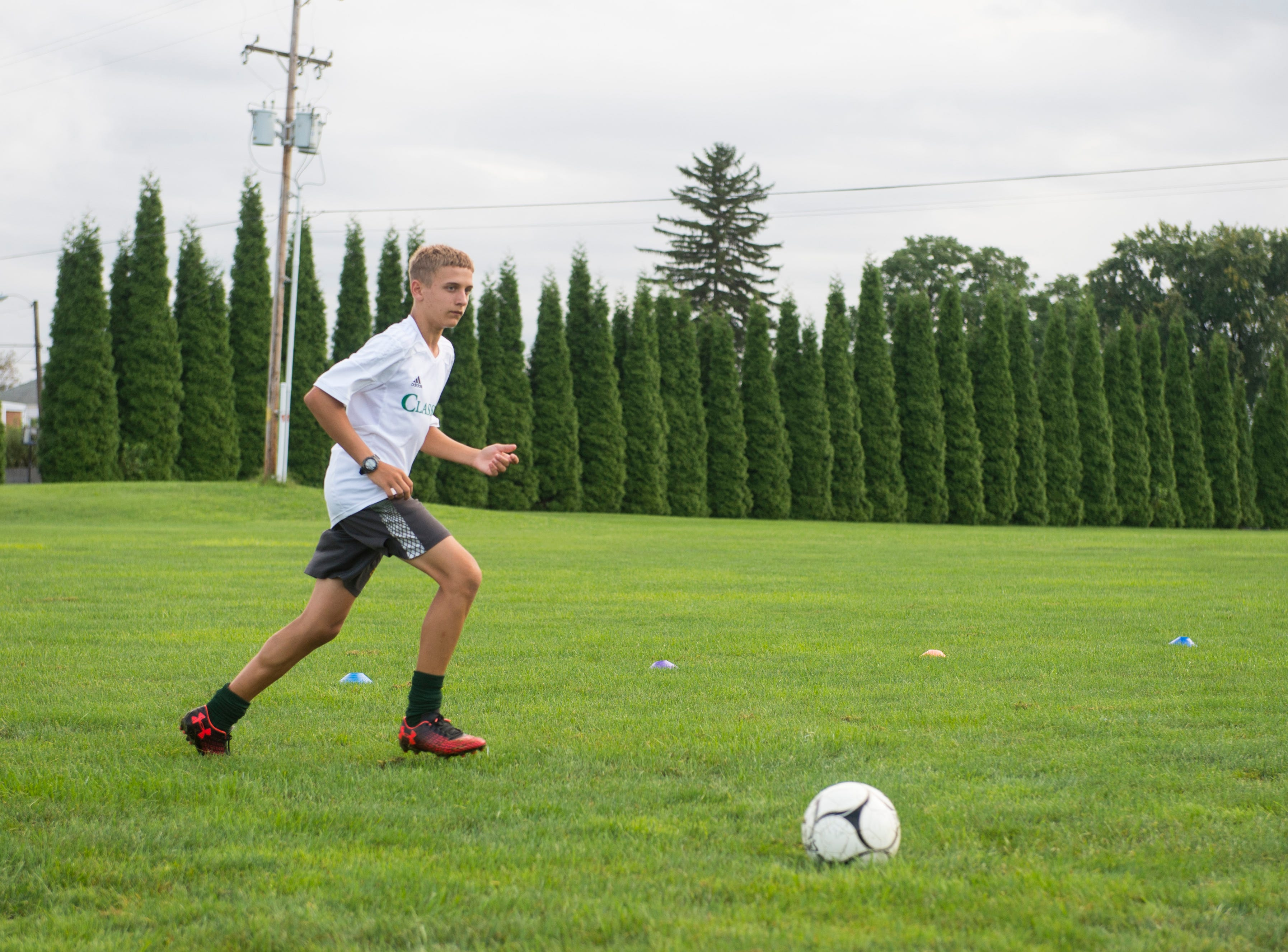 York Catholic boys' soccer takes the field during the first day of fall practice.