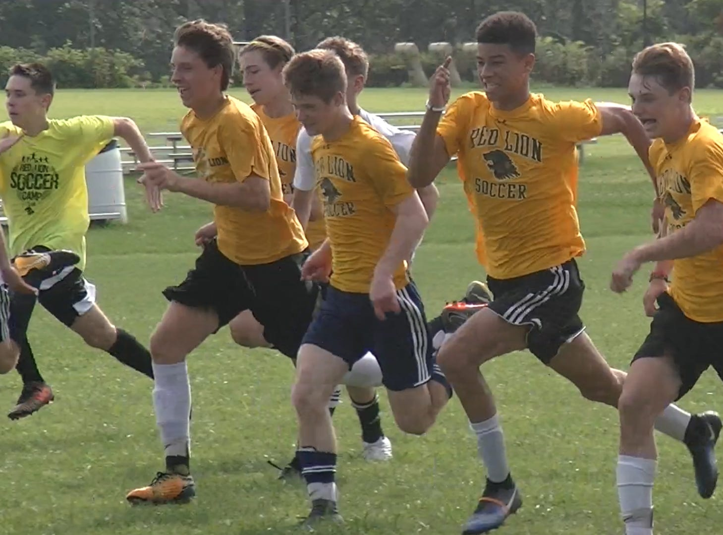 Members of Red Lion boys' soccer team complete wind sprints at the end of the team's first practice Monday, Aug. 13, 2018.