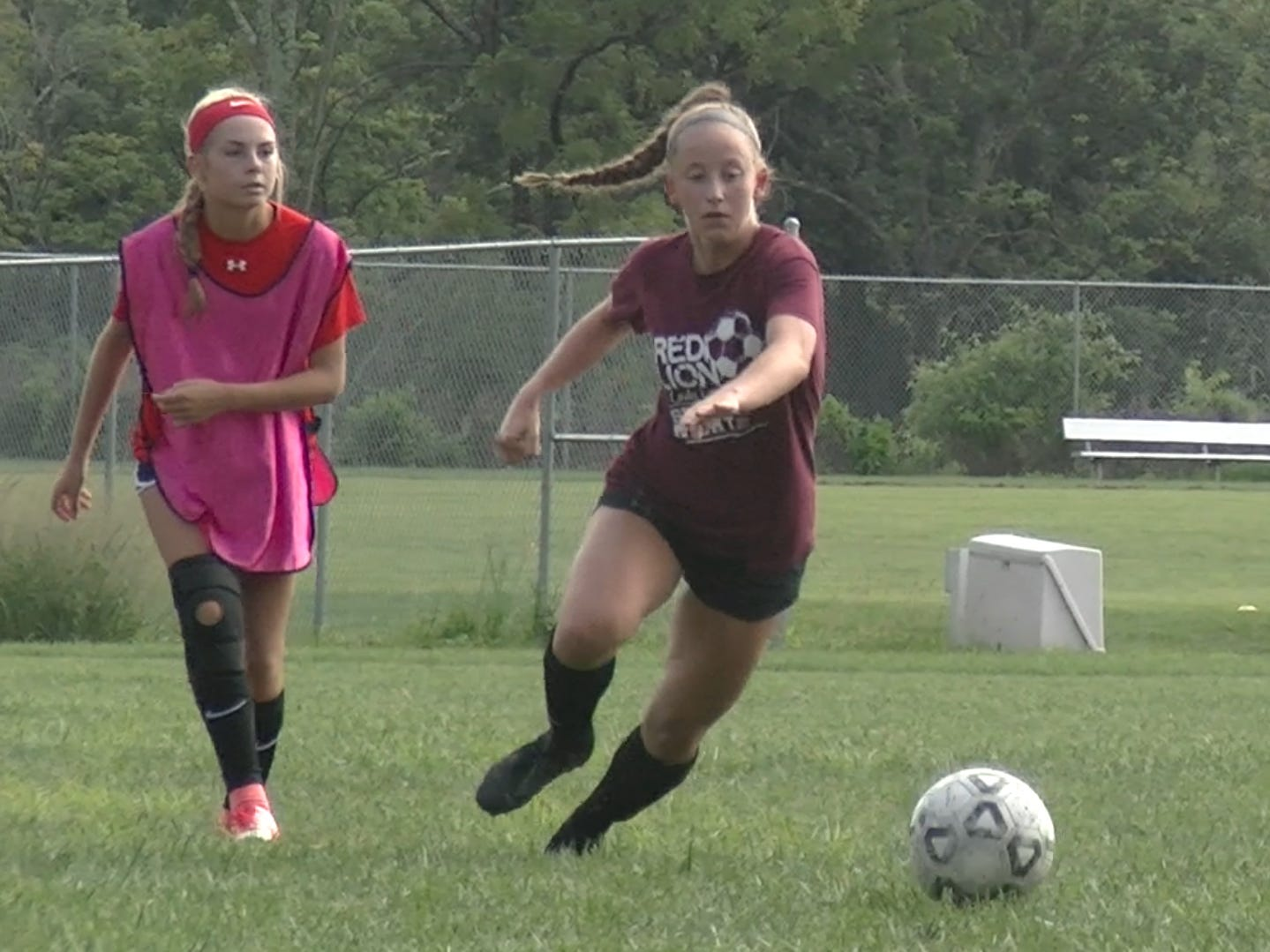Members of Red Lion girls' soccer team scrimmage on the first day of fall sports practice Monday, Aug. 13, 2018.