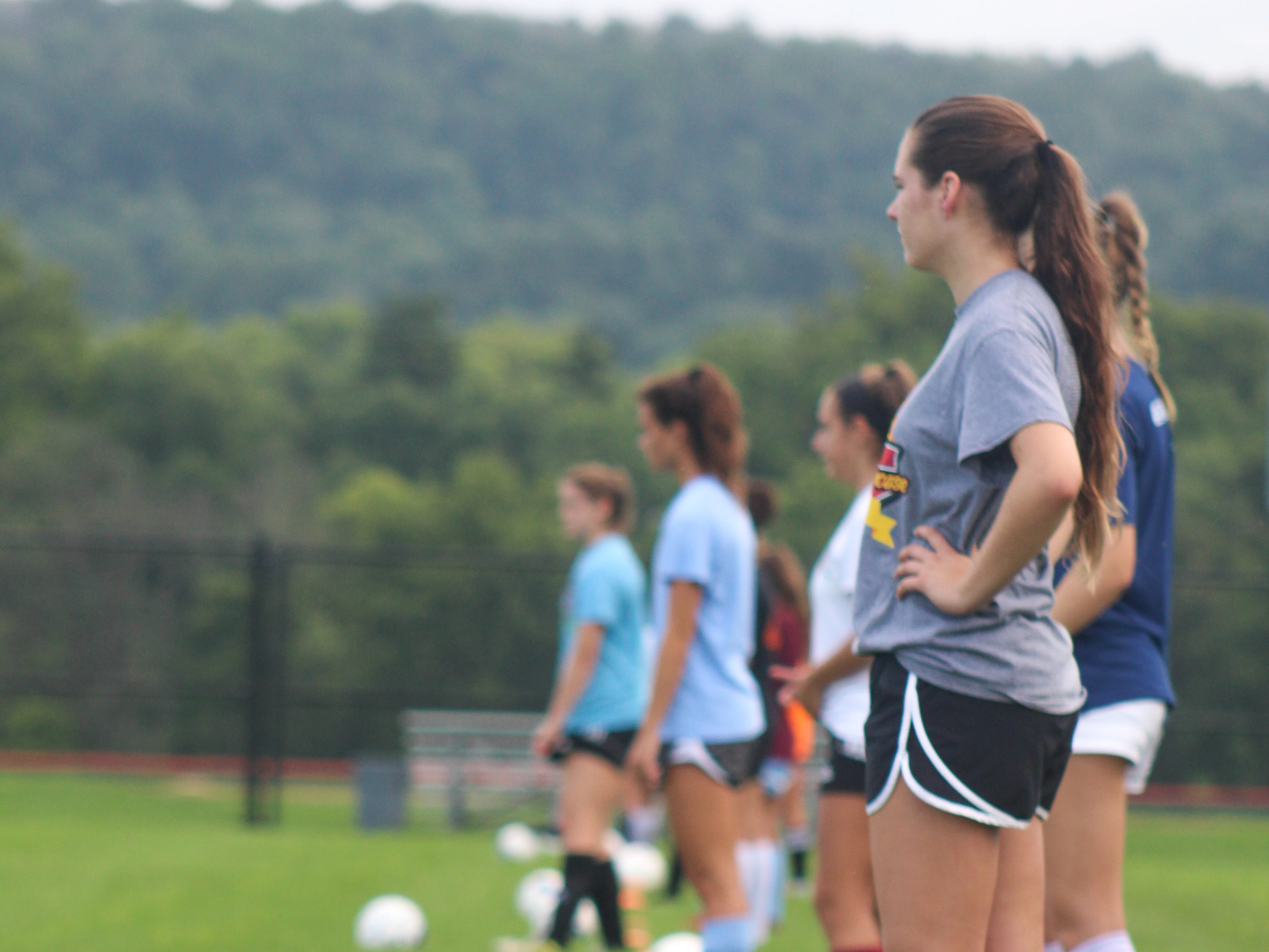 Central York High School soccer players prep for a drill on the first day of fall practices.
