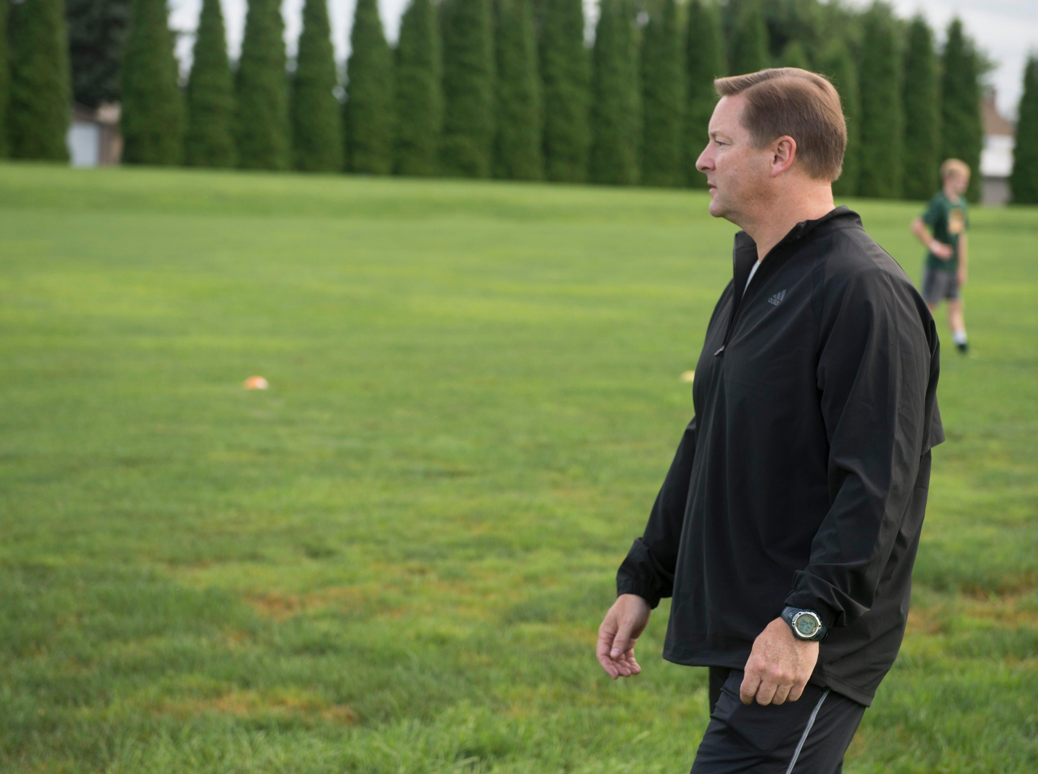 York Catholic head coach Joe Nattans looks over practice.