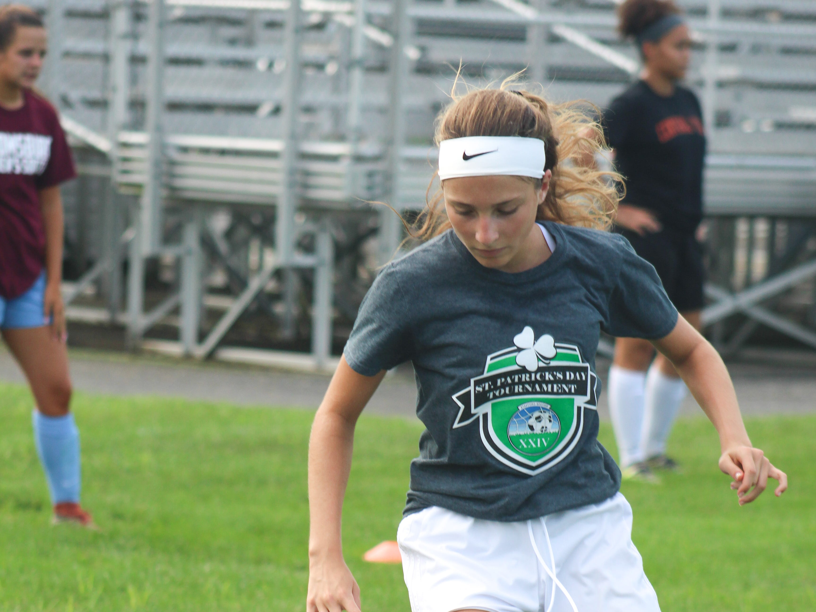 A Central York High School soccer player runs through a drill on August 13, 2018.