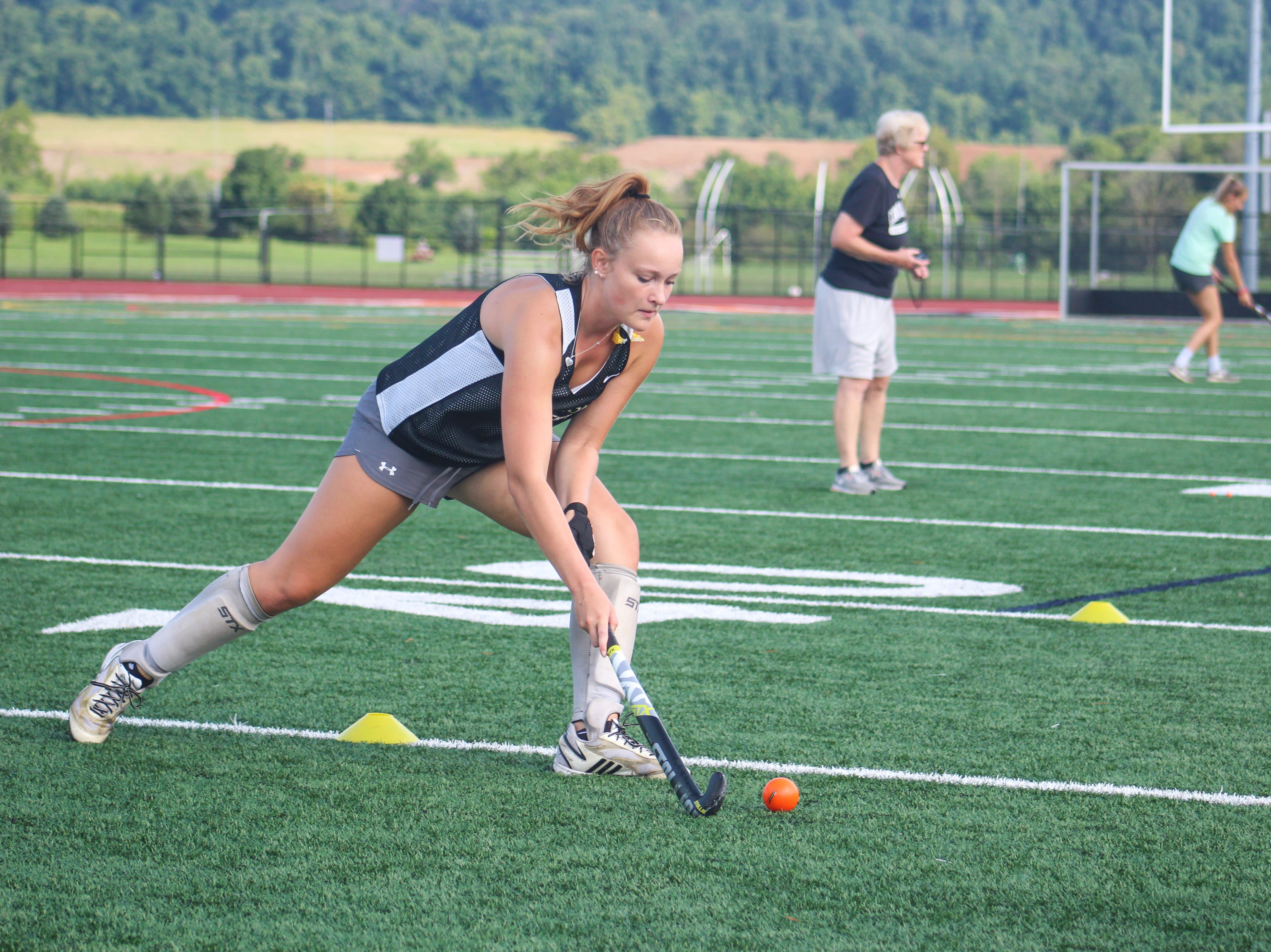A Central York High School field hockey player makes a pass during practice.