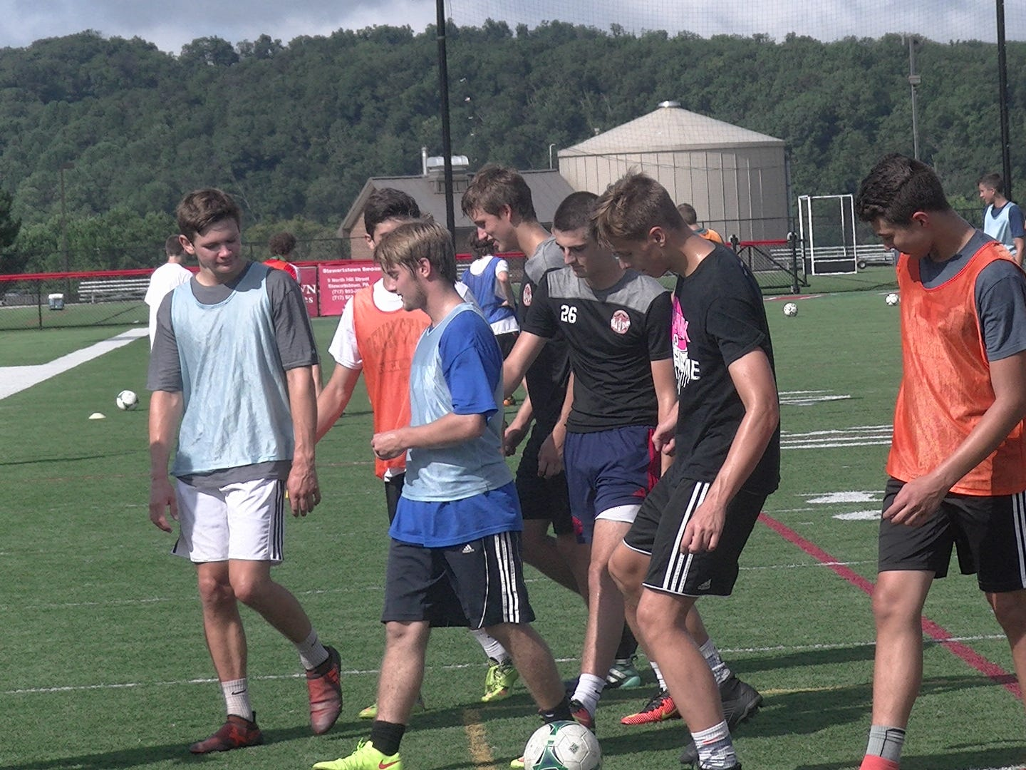 Susquehannock boys' soccer players walk off the field at the end of the first day of practice Monday.